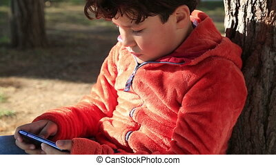 Young boy gaming on smart phone