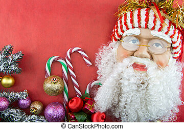 Santa on red with Christmas ornaments and copy-space