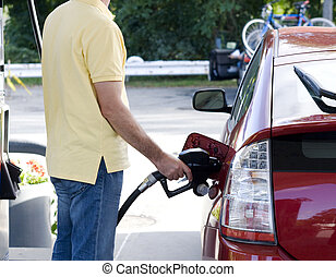 Petrol filling - Man standing at petrol tank and is filling...