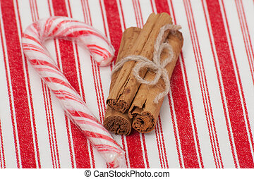 Christmas Candy Cane Cinnamon Sticks On Red White Napkin