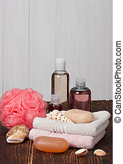 Spa Kit. Shampoo, Soap, Body Lotion. Towels. Wooden Background