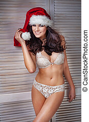 Sexy Santa Claus woman posing in red hat. - Sensual sexy...