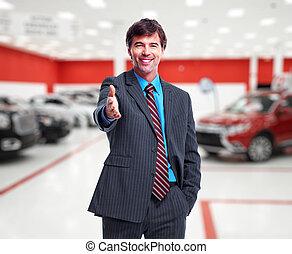 Car dealer handshake. - Car dealer man. Auto dealership and...