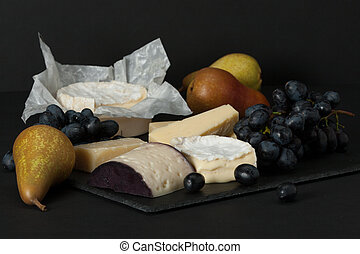 Assorted Cheese On Slate Stone. Grapes, Pears