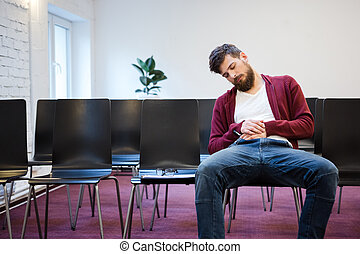 Young man falling asleep at conference room - Young man with...