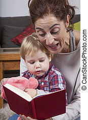mom reading tale to baby