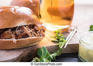 simple steet food, pulled pork bap and beer