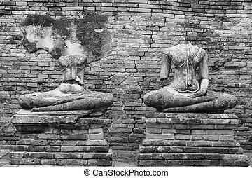Old headless broken buddha statue at Ayutthaya Thailand in...