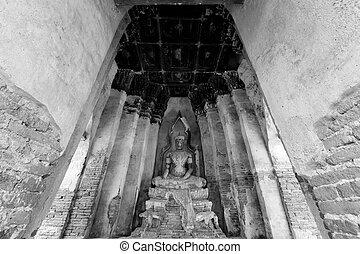 Buddha statue at Ayutthaya Thailand in black and white