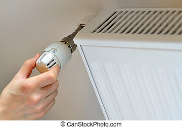 Woman's Hand Adjusting Thermostat