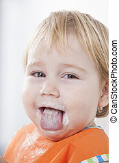 sticking out tongue eating - blonde caucasian baby seventeen...