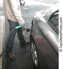 Filling up - Man fills up the car with unleaded gasoline
