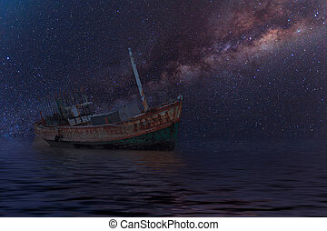 The wrecked ship under starry night with clearly  milky way
