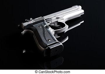 handgun on black background - the handgun on black...