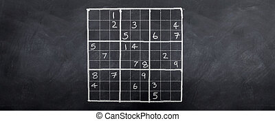 Sudoku Difficult - A game of sudoku played on a blackboard