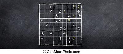 Sudoku Champion - A game of sudoku played on a blackboard