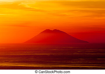 Stromboli volcano at sunset - A view of Stromboli from...