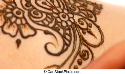 Art of mehendi. Master go on working on models back, close up, cam moves top down