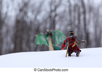 Knight and Dragon - a knight going out to slay a dragon