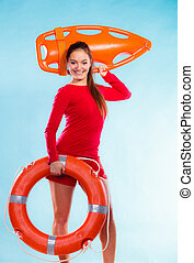 Girl lifeguard with rescue equipment - Accident prevention...