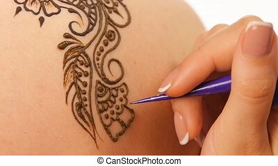 Woman`s hand decorated with mehendi, on white, close up, cam...