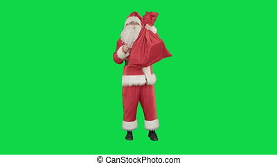 Santa claus with a sack of gifts dance on a Green Screen...