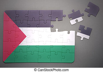 puzzle with the national flag of palestine - broken puzzle...