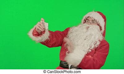 Santa Claus take a selfie on a Green Screen Chrome Key -...