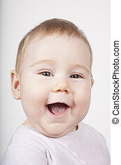baby face smiling - portrait of eight months age blonde...