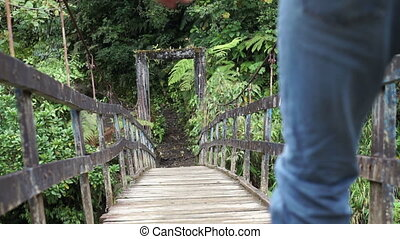 Man on Hanging Bridge Going Low - Low angle shot of a hiking...