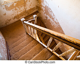 Old staircase in abandoned house of namibian Kolmanskop Ghost Town