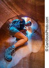 Hiking Peekaboo Slot Canyon - Girl Hiker Climbing Narrow...