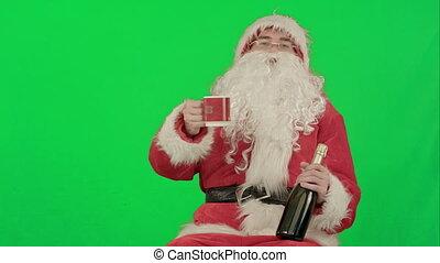 Santa Claus celebrating champagne on a Green Screen Chrome Key