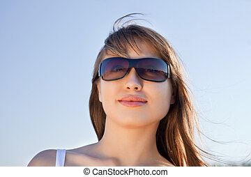 Attractive young blond woman in sunglasses