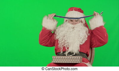 Santa Claus holding Christmas gifts on a Green Screen Chrome...