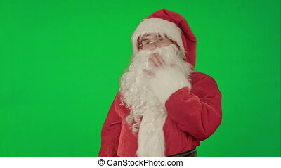 Santa Claus dancing in costume on a Green Screen Chrome Key
