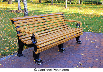 bench in the autumn park, selective focus