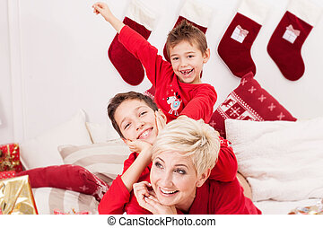 Pretty mother with sons, christmas time.
