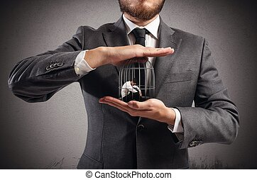 Caged  businessman  - Boss holds in hands a caged man