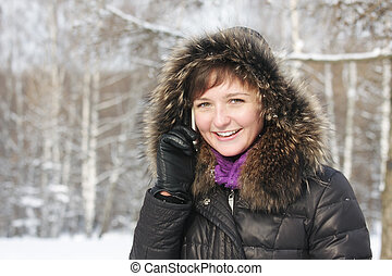 Positive woman on cellphone in frosty day - Positive young...