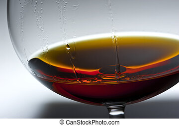Play of light and colours in a glass with alcohol