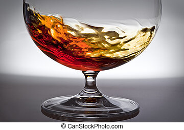 Alcohol in glass, game of light - Raging liquid of alcohol...
