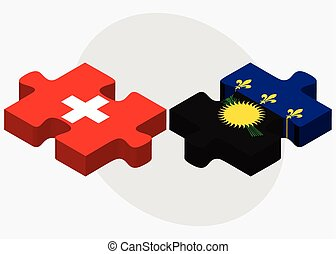 Switzerland and Guadeloupe Flags in puzzle isolated on white...