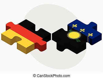 Germany and Guadeloupe Flags in puzzle isolated on white...