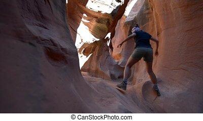 Hiking Peekaboo Slot Canyon - Girl Hiker Climbing Narrow...