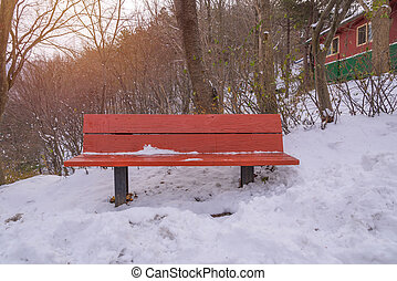 Snow on wood bench in park of winter