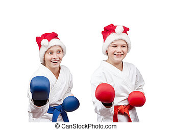 Athletes stand in rack - In caps of Santa Claus and with...