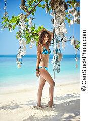 beautiful girl in bikini on the tropical beach
