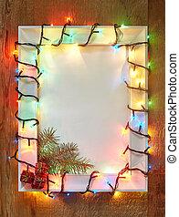 Christmas lights frame on wooden background