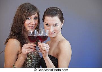girls toasting wine